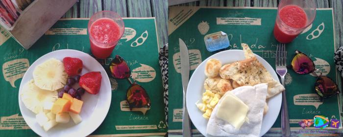 Prato com frutas e suco de melancia e prato com algumas opções salgadas